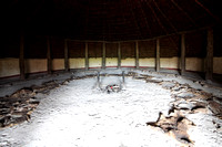 Interior of an Iron Age roundhouse reconstructed at Butser Ancient Farm, Hampshire